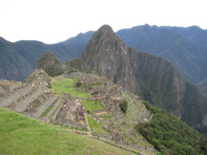 The peak of Huayna Picchu rising up behind the main site.